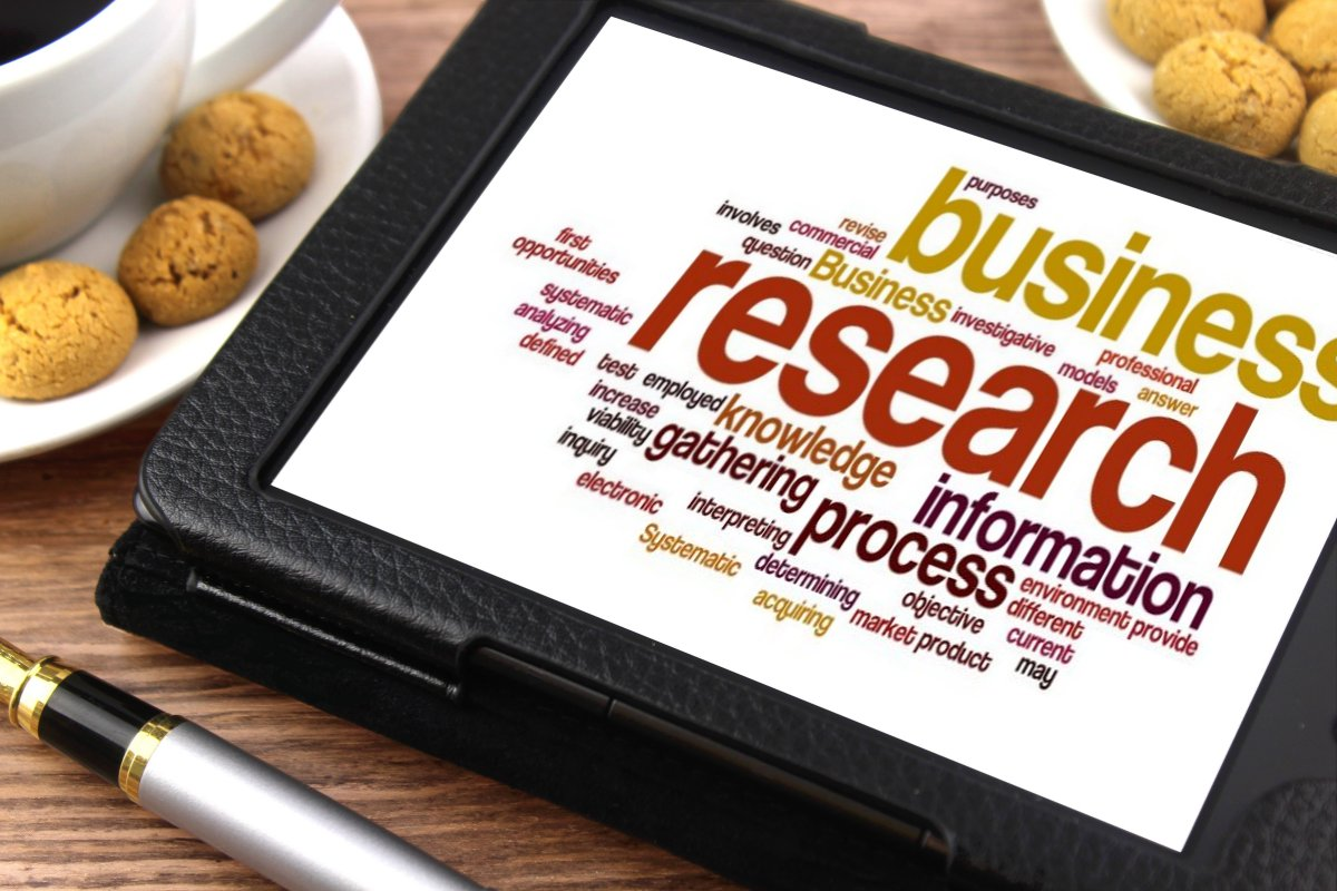 Business research word cloud in a tablet